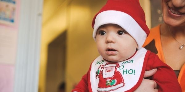 Baby in a Santa Claus outfit